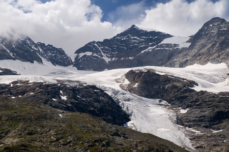 The Bernina Range is a mountain range in the Alps of eastern Switzerland and northern Italy. It is considered to be part of the Central Eastern Alps. It is one of the highest ranges of the Alps, covered with many glaciers photo
