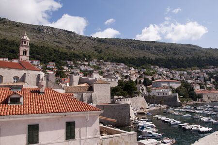 nicknamed: Walking the City Wall of Dubrovnic in Croatia Europe looking down on the city. It is one of the most prominent tourist resorts of the Mediterranean, Dubrovnik is nicknamed Pearl of the Adriatic