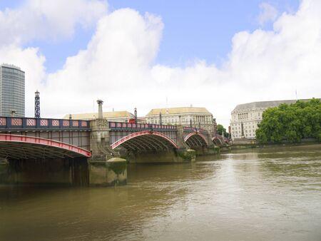 Lambeth Bridge over River Thames in London England photo