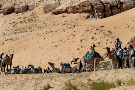 holies: Camel riders in the Sahara desert Egypt Editorial