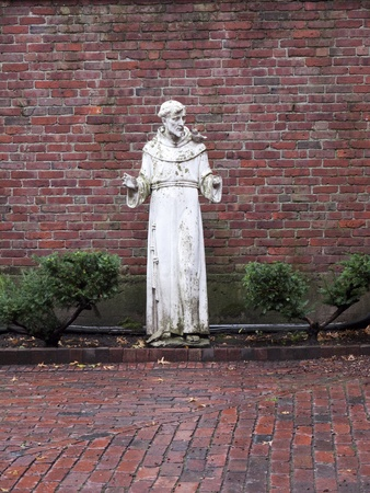 adams: Statue of St Francis. Boston is the capital and largest city in Massachusetts, and is one of the oldest cities in the United States. The largest city in New England, Boston is regarded as the unofficial Capital of New England