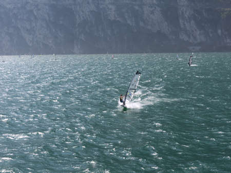 windsurfers: Lake Garda in Northern Italy is famous for its constant breezes which makes this a windsurfers paradise