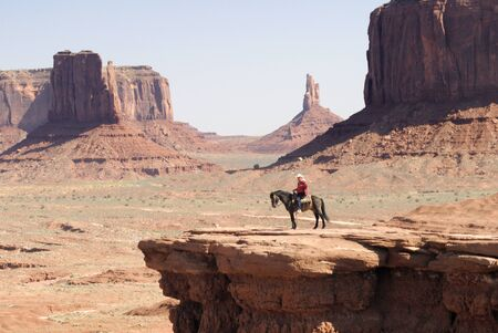 john wayne: Rider close to the Buttes in Monument Valley, Navajo Tribal Lands Utah Stock Photo
