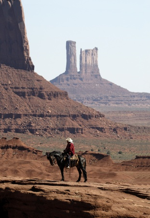 mesas: Rider close to the Buttes in Monument Valley, Navajo Tribal Lands Utah Stock Photo
