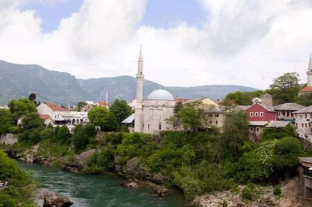 neretva: Mostar was named after  the bridge keepers (natively: mostari) who guarded the Stari Most (Old Bridge) over Neretva river. The Old Bridge is one of the city Stock Photo