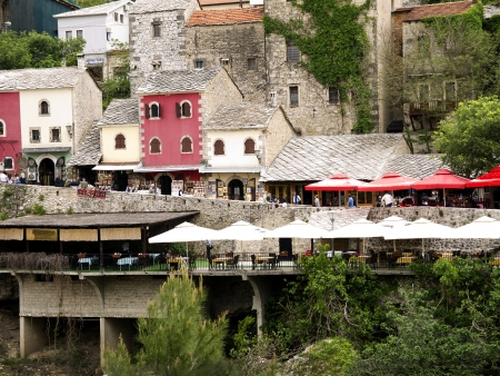 Buildings in the city of Mostar which was named after  the bridge keepers (natively: mostari) who guarded the Stari Most (Old Bridge) over Neretva river.