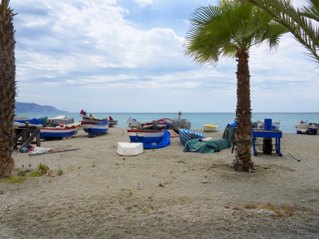 Fishermen on the beach in Nerja on the Costa del Sol in Andalucia Spain