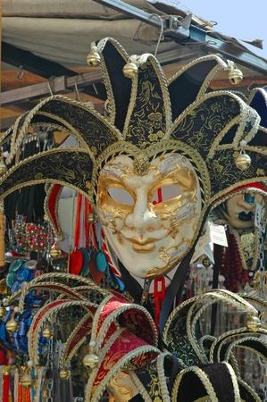 gondoliers: Venetian Mask on sale in market in Venice Italy Stock Photo
