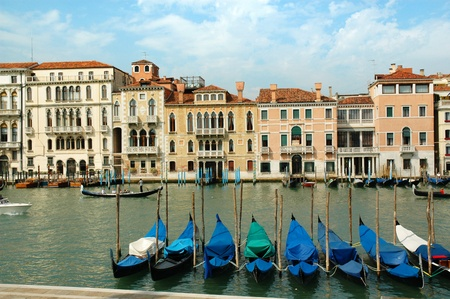 Gondolas moored on the Grand Canal in Venice Italy photo