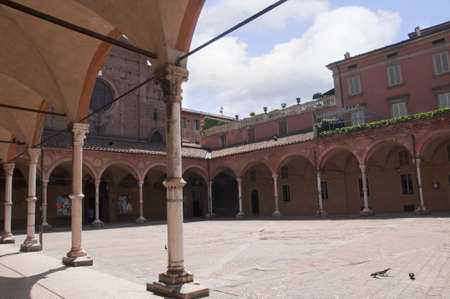 university fountain: Church and Cloister in the Beautiful City of Bologna Italy