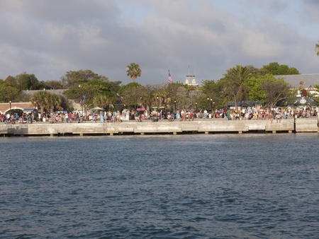 Crowds watching the sunset in Mallory Square Key West Florida USA photo