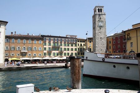 Riva del Garda is one of the lovely small towns on this lake in Northern Italy. Lake Garda is a popular European tourist destination situated near the Dolomites and Italian Alps. Stock Photo - 14543742