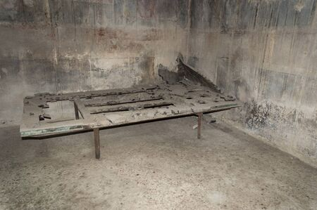 surviving wooden bed in the Buried Roman City of Herculaneum near Naples in Southern Italy