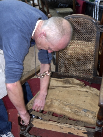 upholster: Master Upholsterer working on a late Victorian Chair in Burnley Lancashire Editorial