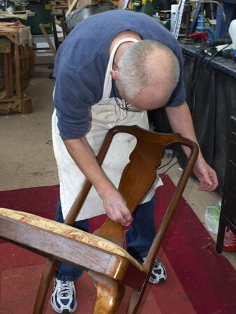 Master Upholsterer working on a late Victorian Chair in Burnley Lancashire Stock Photo - 14543956