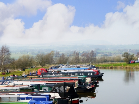 Reedley Boat Marina on the Leeds and Liverpool Canal is in northern England, linking the cities of Leeds and Liverpool.  Stock Photo - 14543959