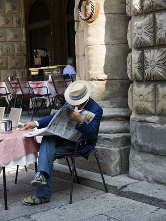church bell: Morning coffee in Piazza Maggiore Bologna Italy Editorial