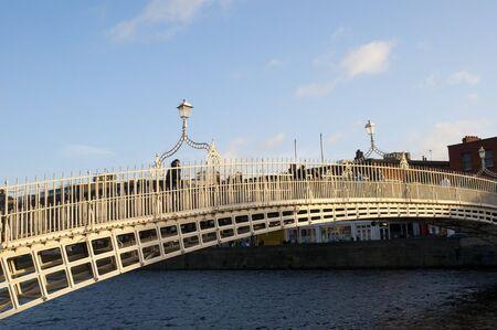 The Ha penny Bridge  over the River Liffey in Dublin City Ireland photo