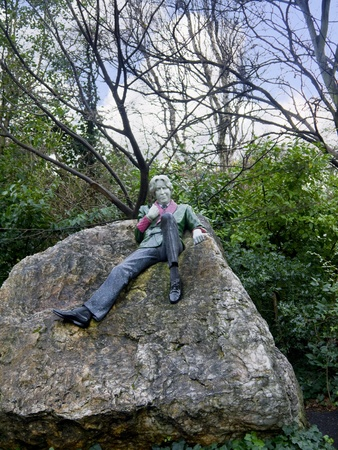 stateroom: Statue of Oscar Wilde, writer in Merrion Square Park in Dublin Ireland