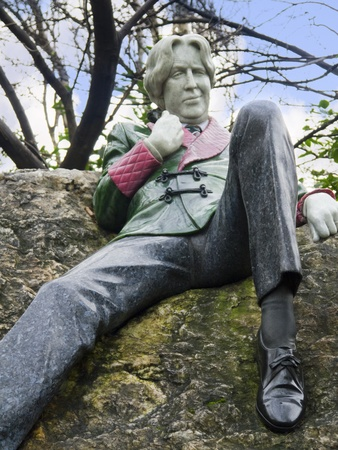 Statue of Oscar Wilde, writer in Merrion Square Park in Dublin Ireland photo