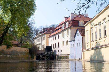 Water wheel in side canal in Prague, Czech Republic Europe photo