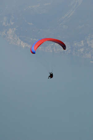 Hangglider from the top of Monte Baldo above Malcesine Lake Garda Italy Stock Photo - 12546352