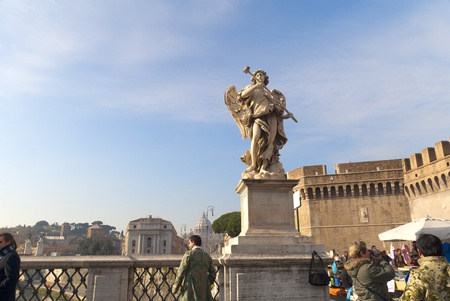 Angel on the SantAngelo Bridge over the River Tiber in Rome Italy