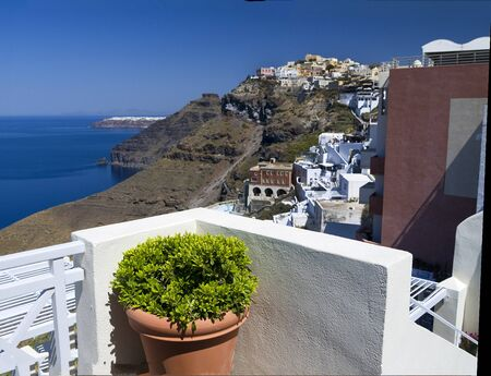 fira: Sunny Terrace above the Caldera in Fira Santorini Greece