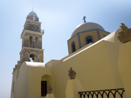 The tower of the Catholic Cathedral in Fira Capital of the Island of Santorini Greece photo