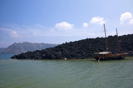 eacute: Sailing Boat moored off the Volcano in the Caldera of Santorini Cyclades Greece