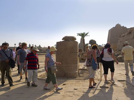 holies: walking 7 times anti-clockwise around a carved Scarab brings good health to the participant in Karnak Temple in Egypt Editorial