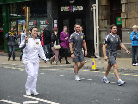 burnley: Olympic Torch runs through Burnley in Lancashire