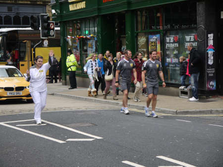 lancashire: Olympic Torch runs through Burnley in Lancashire
