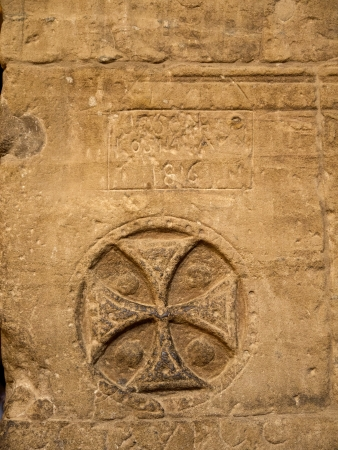 holies: Christian Cross in The Temple to Isis, Horus and Osiris on Philae Island on the River Nile in Egypt Stock Photo