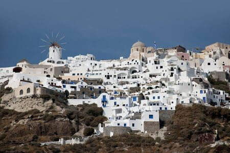 Windmill in the Town of Oia on the Island of Santorini Greece photo