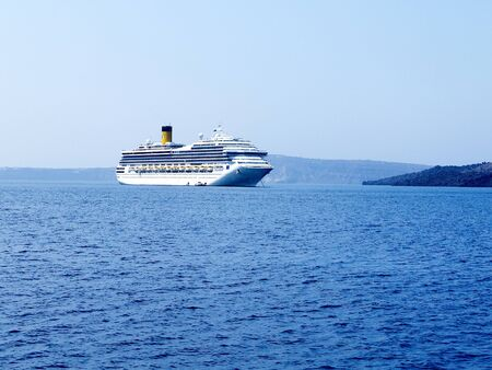 Cruise Ship in the Caldera of the Island of Santorini Greece photo