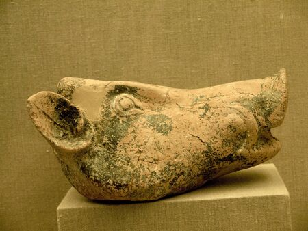eacute: Pottery Pig from Akrotiri a city buried by the explosion of the volcano on Santorini 4000 years ago that may be the lost city of Atlantis