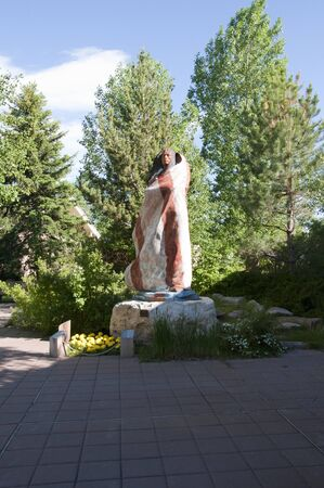 Statue of Native American Woman in Cody Wyoming USA photo