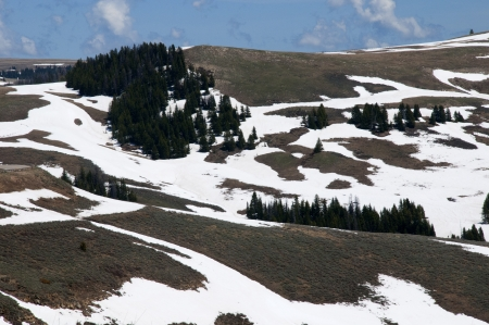 Snowfields on mountains above Jackson Hole photo