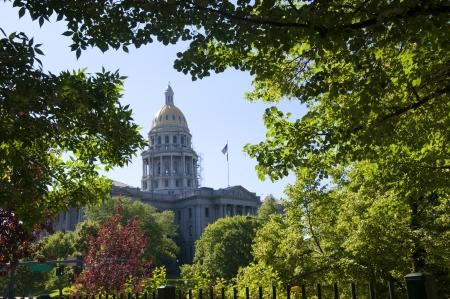 denver skyline with mountains: The Statehouse of Denver Colorado USA
