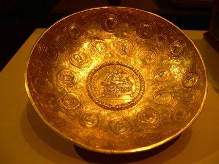 pavillion:       Golden bowl with heads of Roman Emperors     Stock Photo