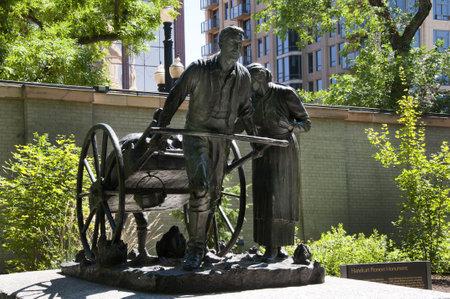 pioneers: Statue to the Handcart Pioneers of Utah in Temple Square in Salt Lake City Utah USA Editorial
