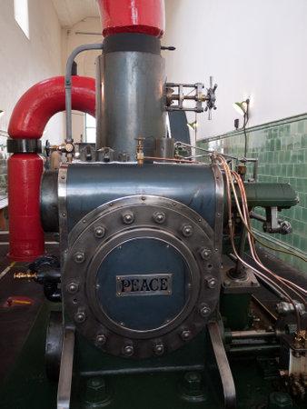 flywheel: Steam Engine in a Lancashire Cotton Mill England