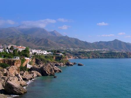 Beach scenes in Nerja, a sleepy Spanish Holiday resort on the Costa Del Sol  near Malaga, Andalucia, Spain, Europe photo