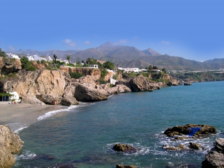 malaga: Beach scenes in Nerja, a sleepy Spanish Holiday resort on the Costa Del Sol  near Malaga, Andalucia, Spain, Europe