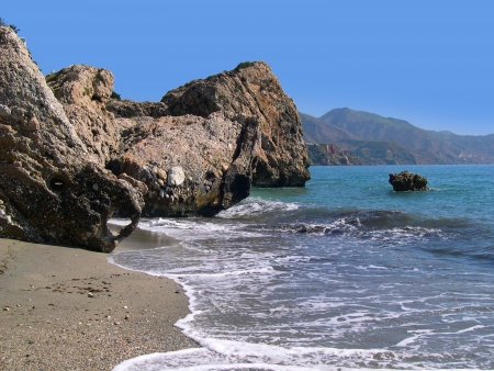 Beach scenes in Nerja, a sleepy Spanish Holiday resort on the Costa Del Sol  near Malaga, Andalucia, Spain, Europe Stock Photo - 14810452