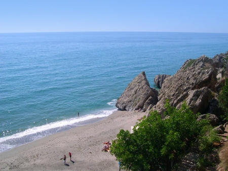 Beach scenes in Nerja, a sleepy Spanish Holiday resort on the Costa Del Sol  near Malaga, Andalucia, Spain, Europe photo
