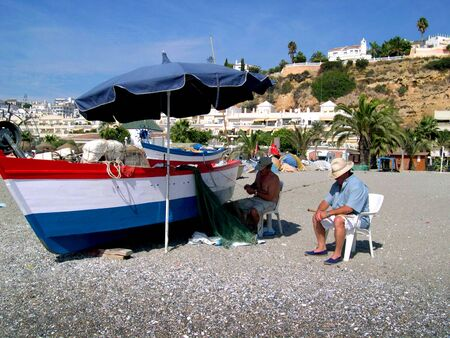 burriana beach:       Fishermen on the Burriana beach at Nerja Andalucia Spain