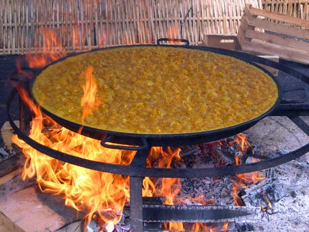 Cooking a gigantic paella on the beach at Nerja Andalucia Spain photo