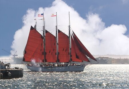brenda kean: Cannons firing in mock sea battle with Tall Sailing Ships in Harbour of San Diego California USA Stock Photo